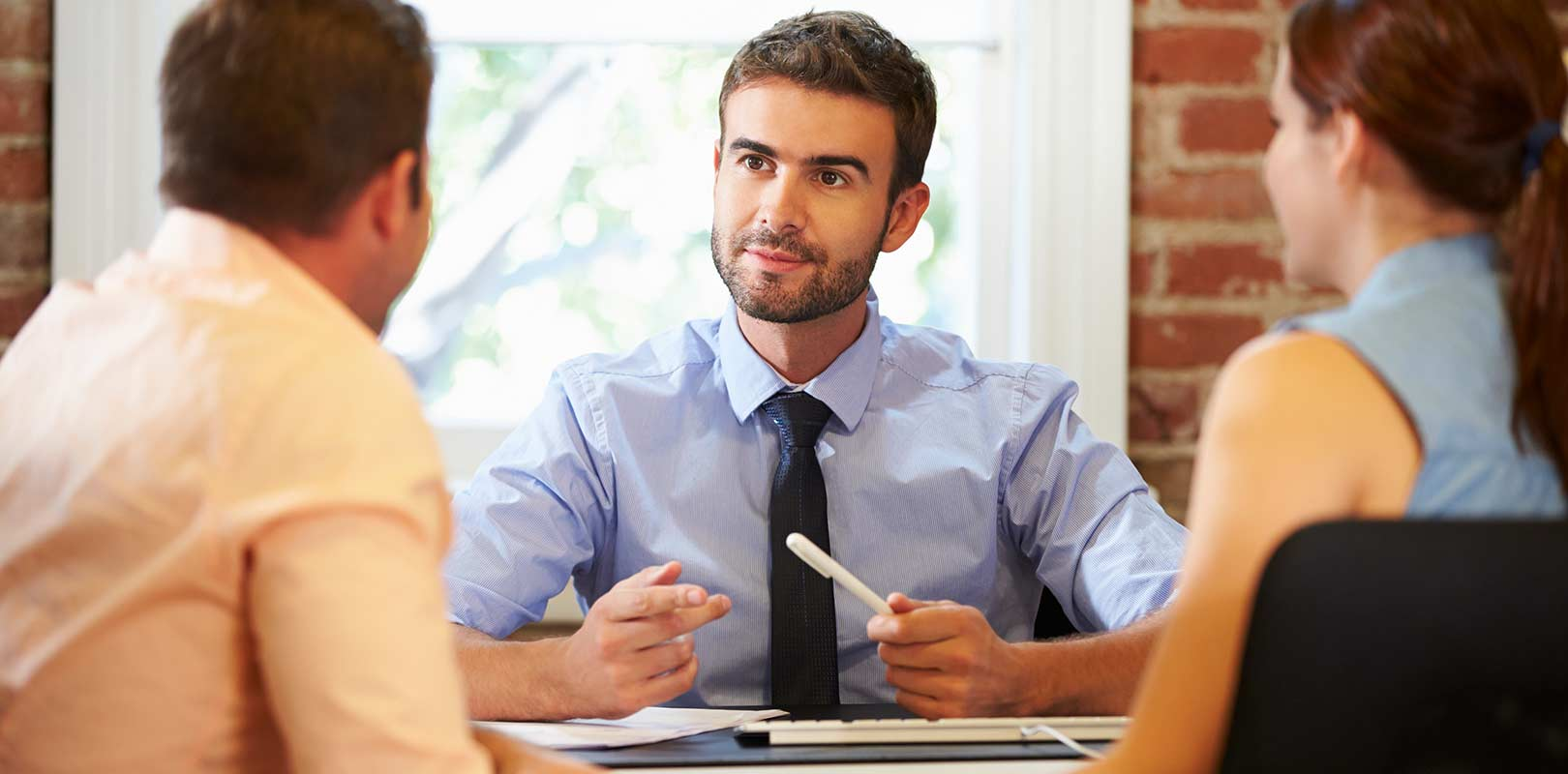 Financial advisors with clients in an office
